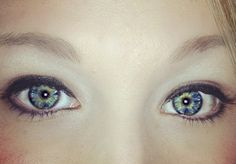 I have always described my eye color as grey because the green and blue appear grey from a distance. Apparently it's called heterochromia. More specifically, I have central heterochromia. It is basically a beautiful mutation. The eyes are the window to the soul. In my eyes I see the soul of a dreamer with a wild side.