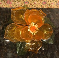 Shape of flower can be changed as flowers are attached to adjustable to wire. See photo for blemish on tip of one flower petal. Hippie Flowers, Acrylic Resin, Orange Flowers, Flower Petals, Green Leaves, See Photo, Centerpieces, Shapes, Painting
