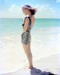 Model wearing a leopard print swimsuit, photographed by Tom Palumbo, 1950s.