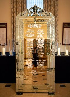 10 Fantastic New Wedding Escort Card Ideas: This ornate mirror, featuring calligraphy, takes the place of traditional escort cards. Wedding Reception Ideas, Wedding Table, Reception Decorations, Wedding Places, Wedding Place Cards, Wedding Signs, Diy Wedding, Dream Wedding, Seating Chart Wedding
