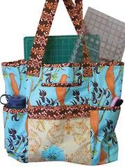 """This monstrous tote has pockets galore.    This monster tote meets all needs: Great as an overnight or carry-on for trips—a terrific diaper bag—a tote to lug your quilting supplies to a class or retreat. This bag is useful for quilting supplies because it fits 18"""" x 24"""" cutting mats. There are plenty of pockets for every need. Finished size: 23""""W x 20""""H x 5""""D."""