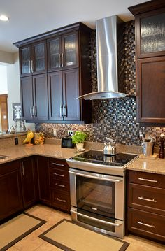 Catalina kitchen with extended height cabinets featuring glass inserts-royalhomes.com