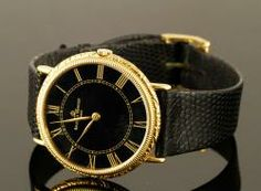 Wear it well, 18K Gold Baume & Mercier Watch  bid online April Estate Auction   Kaminski Auctions