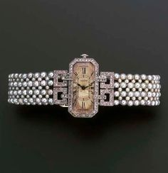 A LADY'S ART DECO DIAMOND AND PEARL WRISTWATCH, BY CARTIER The cut-cornered rectangular cream dial with black Roman numerals within rose-cut diamond border and winder, set perpendicular to the square openwork diamond shoulders, seed pearl mesh bracelet and diamond panel shoulers, buckle deployant clasp, circa 1915
