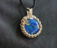 Polymer clay faux lapis with Soutache braided wire bezel. The wire is actually extremely fine coils of wire.