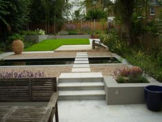 Contemporary garden with a clear progression of spaces leading to an 'L' shaped lawn.