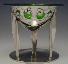 Art Nouveau - 1904 Tudric polished pewter tazza with a green glass liner with typical Archibald Knox decoration