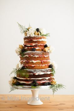 naked tiered wedding cake with stacked delicious fresh fruit and seasonal flowers by Miss Ingredient