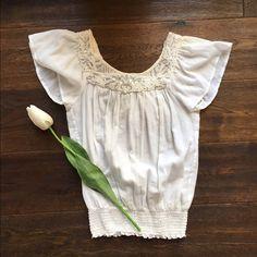 Karen Kane XS white top Cute Karen Kane detailed top with elastic waist. In great condition!! Karen Kane Tops Tees - Short Sleeve