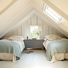 I take back what I said about pastels - I like the feel of the bedding, like the trunk. Would like more color punches, but as a base and feel, it's good.   Extra attic space can become a cozy sleeping nook. White paint makes the tight space feel airier.