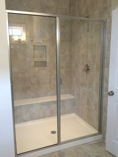 Master shower with Daltile Grigio Perla tile in 10x14 layed vertically.