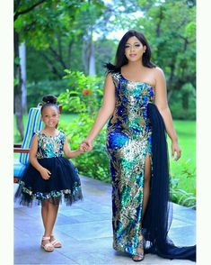 15 Elegant Mother Daughter Ankara Fashion Styles Here are top breathtaking mom and daughter Ankara fashion styles you don't want to miss and if you African Dresses For Kids, African Maxi Dresses, Latest African Fashion Dresses, African Attire, Ankara Fashion, Xhosa Attire, African Lace Styles, Ankara Styles, Party Outfits For Women