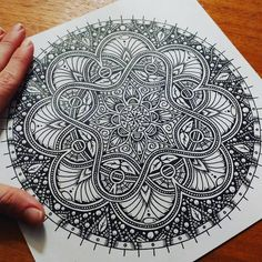 Symmetry Balance and Harmony in Mandala Drawings. By Jody Romero.