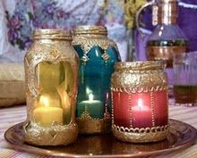 gold puffy paint and glass stain turns used jars into beautiful lanterns.