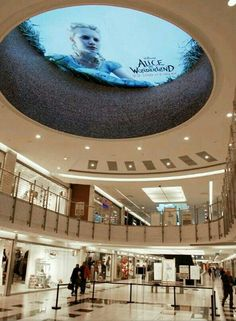 Creative ad in a mall, promoting Alice and Wonderland. How eye catching! #outdoorads