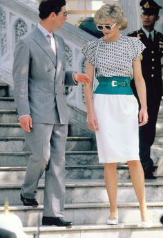During an official visit in Bangkok with Prince Charles, Diana wowed in oversized shades and waist-cinching skirt and top.