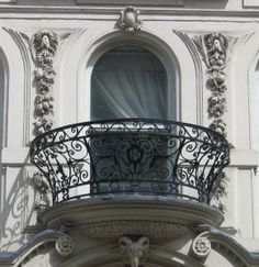 Google Image Result for http://www.sxc.hu/pic/m/a/ay/ayla87/785376_wrought-iron_balcony.jpg