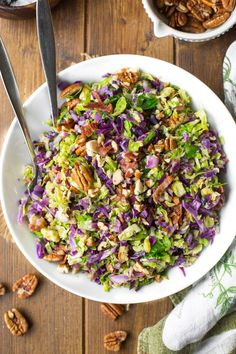 Shredded Brussels sprouts and chopped cabbage salad topped crispy bits of bacon and chopped pecans | Gluten Free + Whole30 + Low Carb