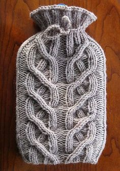 Ravelry: Cabled Hot Water Bottle Cosy pattern by Alexis Layton Free Pattern Cable Knitting Patterns, Knit Patterns, Crochet Pattern, Crochet Teacher Gifts, Water Bottle Covers, Crochet Cord, Chunky Yarn, Knitting Accessories, Knitted Blankets