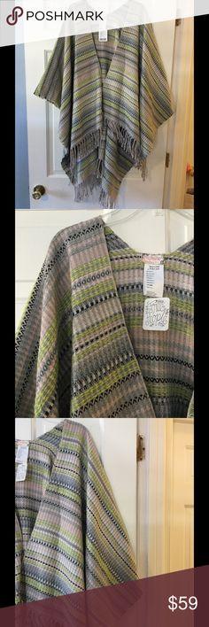 "🆕 Free People fringe shawl Roomy fringed shawl, one size. Length 24-42"".  100% acrylic. Hand wash.  Brand new with tag. Free People Sweaters Shrugs & Ponchos"