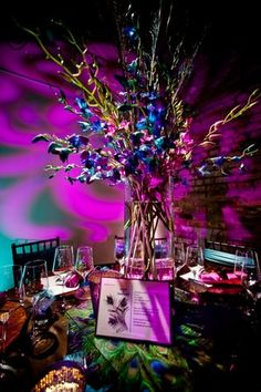 Get expert wedding planning advice and find the best ideas for wedding decorations, wedding flowers, wedding cakes, wedding songs, and more. Peacock Theme, Peacock Wedding, Purple Wedding, Wedding Colors, Wedding Flowers, Peacock Colors, Purple Peacock, Peacock Feathers, Wedding Centerpieces
