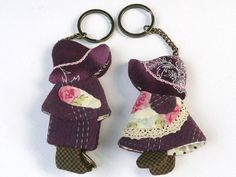 """This size mini measurements is  - Width: 6cm (edge to edge of skirt) Height: 9cm (edge of hat to sole of shoe) Features : Use the top key ring for your car / motorcycle key and the bottom key holder for your house door key, or office drawer key or thumb drive. If you wish to see more of this, please click on """"From facebook.com"""" which is located on the top right hand corner of this photograph."""