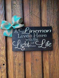 """""""A Lineman Lives here with the Light of his Life"""" door/wreath hanger. Shown here with a white/grey stain, black vinyl words, and a blue vinyl lineman. Measures wire hanger attached Different colors are available Mommy's Crafty Closet Original Lineman Love, Lineman Gifts, Power Lineman, Vinyl Crafts, Home Crafts, Diy And Crafts, How To Make Signs, Making Signs, Electrical Lineman"""