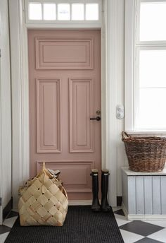 Beautiful blush front door with black & white tiled floor. #frontdoor #blush #interiordesign
