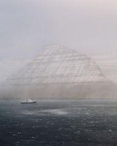 A fishing tanker battles through a snow storm off the island of Kallsoy Faroe Islands by robbiel1 on Instagram