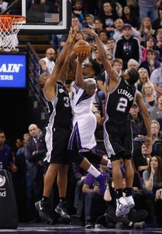 Sacramento Kings forward Rudy Gay,  San Antonio Spurs forward Boris Diaw, forward Kawhi Leonard
