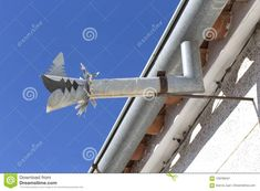Zinc gutter drainage system dragon-shaped over blue sky. Architecture, cornice