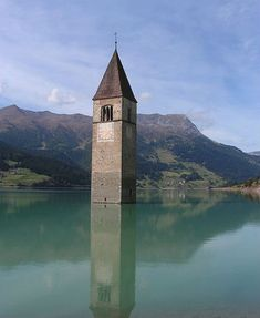 All that remains of the old Curon Venosta is the tip of a bell tower, emerging from Lago di Resia like a tombstone for the flooded town. The alpine village was inundated with water shortly after World War II when officials decided to join three pre-existing lakes into one large man-made lake. The entire town is still down there, filled with sand.
