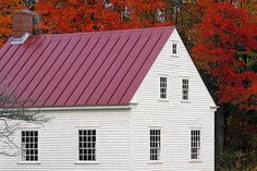 Red roof and red leaves in Shaker village of Pittsfield, Mass.