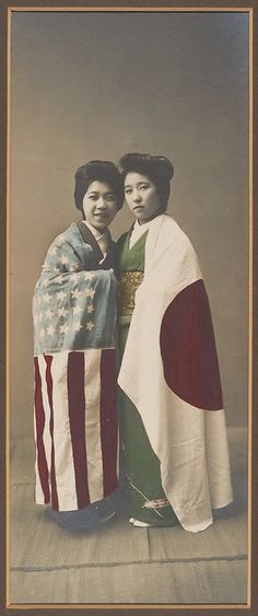 i thought this was quite an interesting photo  [Japanese Women Cloaked in American and Japanese Flags] (1900)