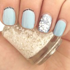 Blue nails with silver sparkly accent nails