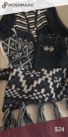 Pretty blue and cream sweater Pretty blue & cream sweater. Long sleeves and made to wear over something. Different designs throughout. Bottom has fringe all the way around. Very cute & in excellent condition. Faded Glory Sweaters