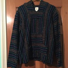 A rug sweatshirt It's a blue, purple, and gray rug sweatshirt, very warm, also has colorful dots all over it! Sunspecs Sweaters Shrugs & Ponchos