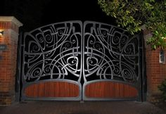 This unique double gate is electronically operated and was designed and made By allerford Forge Blacksmithing head Blacksmith Dominic Hesp. The gate is truly a unique eye catching piece.