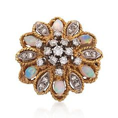 C. 1960. opal and diamond cluster ring;  Features round brilliant cut diamonds and marquise opals in a floral presentation .