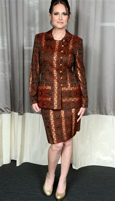 This vintage Mary McFadden by Saks Fifth Avenue is a timeless couture looking skirt suit! The fabric is full of rich tones of Fall colors along with gold toned thread which make a beautiful design throughout!