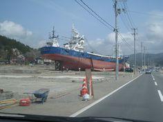huge ship carried by tsunami