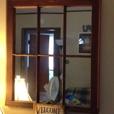 Up cycled old window with mirrors in it...jeff made it
