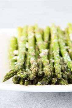 Oven Roasted Asparagus with Garlic, Parmesan, & Lemon is a quick and easy side dish that is especially delicious in Springtime when asparagus is in season!