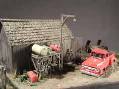 """""""Barn Find"""" HO scale diorama by David King.  This is the other side of the barn.  The fuel and watering station is a mixture of Woodland Scenics detail parts and scratchbuilt stuff.  The shiny '56 Ford pickup is a Model Power diecast, slightly lowered and the wheels changed to turn it into a hot rod.  #davidkingstudio #scalemodel #diorama"""