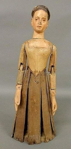German carved wooden dressmaker's doll.  late 19th century, with painted features and articulated arms.