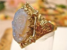 70% OFF Antique 9.0ct Opal, Cameo Carved, Ladies Vintage Edwardian Filigree Ring, Circa 1900, Solid 14K Gold. (Value 5,800 USD). $1,740.00, via Etsy.