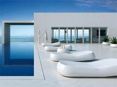 white backdrop against the blue ocean & pool
