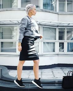 Pin for Later: Proof That a Leather Skirt Is the Most Versatile Piece a Woman Can Own With a Graphic Sweatshirt and Sporty Sneakers