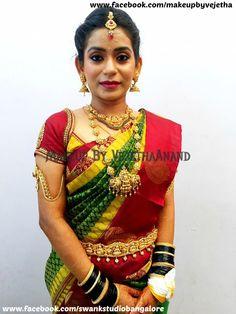 Traditional Southern Indian bride, Smitha wears bridal silk saree and jewellery for her Muhurat. Makeup and hairstyle by Vejetha for Swank Studio. #BridalSareeBlouse #SariBlouseDesign #statementnecklace #goldjewellery #jhumkas #jhumkis #kamarbandh #maangtikka  Silk sari. Tamil bride. Telugu bride. Kannada bride. Hindu bride. Malayalee bride  Find us at https://www.facebook.com/SwankStudioBangalore