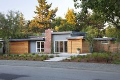 Houzz Tour: An Early Eichler Home Expands by Klopf Architecture  {The original house area now has a smooth, dark stucco finish, while all the additions and the garage have horizontal cedar siding.}